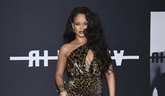 """Singer and fashion designer Rihanna attends the """"Rihanna"""" book launch event in New York on Oct. 11, 2019. (Photo by Evan Agostini/Invision/AP, File)"""