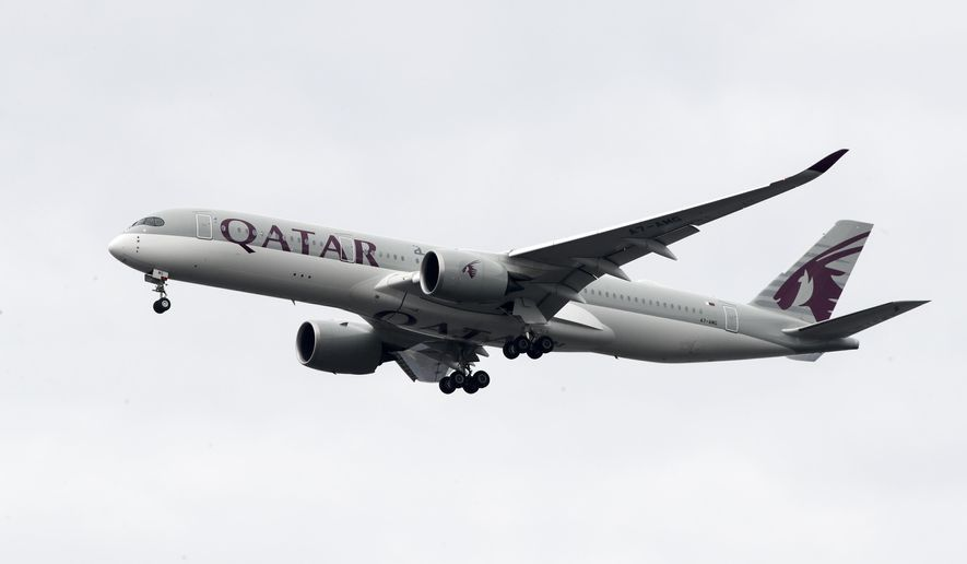 FILE - In this Nov. 7, 2019, file photo, a Qatar Airways jet approaches Philadelphia International Airport in Philadelphia. Qatar apologized Wednesday, Oct. 28, 2020, after authorities forcibly examined female passengers from a Qatar Airways flight to Australia to try to identify who might have given birth to a newborn baby found abandoned at the airport earlier this month. (AP Photo/Matt Rourke, File)