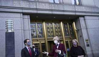E. Jean Carroll, center, who says President Donald Trump raped her in the 1990s, speaks to reporters as she leaves the Daniel Patrick Moynihan United States Courthouse following a hearing in her defamation lawsuit against Trump, Wednesday, Oct. 21, 2020, in New York. (AP Photo/John Minchillo)