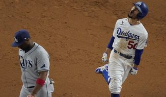 Los Angeles Dodgers' Mookie Betts celebrates after a home run against the Tampa Bay Rays during the eighth inning in Game 6 of the baseball World Series Tuesday, Oct. 27, 2020, in Arlington, Texas. (AP Photo/Sue Ogrocki)