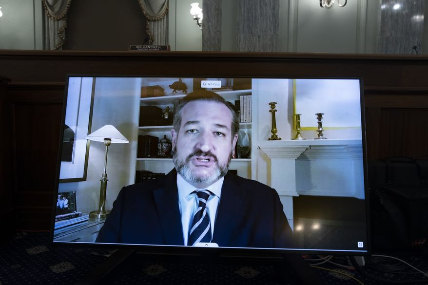 Sen. Ted Cruz, R-Texas, appears on a screen as he speaks remotely during a hearing before the Senate Commerce Committee on Capitol Hill, Wednesday, Oct. 28, 2020, in Washington. The committee summoned the CEOs of Twitter, Facebook and Google to testify during the hearing. (Michael Reynolds/Pool via AP)