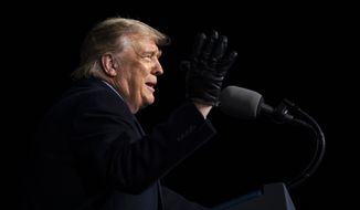 President Donald Trump speaks during a campaign rally at Eppley Airfield, Tuesday, Oct. 27, 2020, in Omaha, Neb. (AP Photo/Evan Vucci)