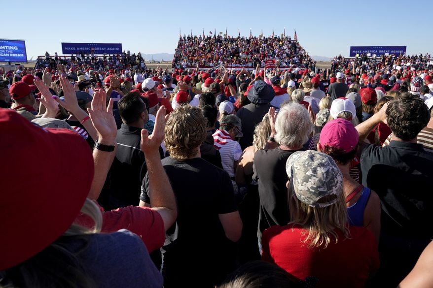 Supporters of President Donald Trump applaud as he speaks at a campaign rally at Phoenix Goodyear Airport Wednesday, Oct. 28, 2020, in Goodyear, Ariz. (AP Photo/Ross D. Franklin)