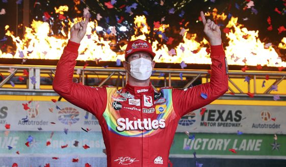 Kyle Busch celebrates in Victory Lane after winning the NASCAR Cup Series auto race at Texas Motor Speedway in Fort Worth, Texas, Wednesday, Oct. 28, 2020. (AP Photo/Richard W. Rodriguez)