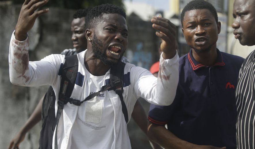 Alister, a protester who says his brother Emeka died from a stray bullet from the Army, reacts while speaking to Associated Press near Lekki toll gate in Lagos, Nigeria. Nigeria's army has on Tuesday, Oct. 27 admitted its soldiers were deployed at the Lekki Toll Plaza in Lagos where live rounds were fired last week, killing several peaceful protesters prompting global outrage. At least 10 protesters were killed in the Lekki plaza shooting on Oct. 20, according to Amnesty International. ( AP Photo/Sunday Alamba, file)