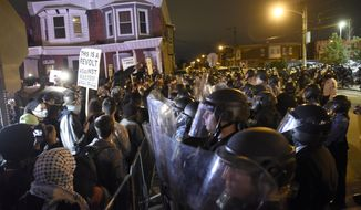 Protesters face off with police during a demonstration Tuesday, Oct. 27, 2020, in Philadelphia. Hundreds of demonstrators marched in West Philadelphia over the death of Walter Wallace Jr., a Black man who was killed by police in Philadelphia on Monday. (AP Photo/Michael Perez)