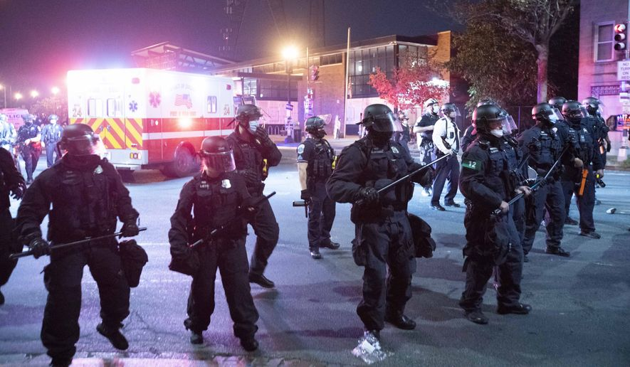 Washington Metropolitan Police Department police officers have been placed on longer shifts and have had additional leave restricted in preparation for unrest in the District in the wake of the verdict in the Derek Chauvin trial in Minneapolis. (AP Photo/Jose Luis Magana) **FILE**