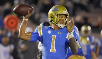 FILE - In this Nov. 30, 2019 file photo, UCLA quarterback Dorian Thompson-Robinson passes during the second half of an NCAA college football game against California in Pasadena, Calif. He is returning for this third season as quarterback (AP Photo/Mark J. Terrill, File)