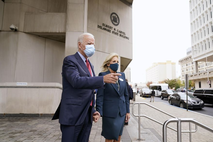 Democratic presidential candidate former Vice President Joe Biden and his wife Jill Biden pause to speak to the media after they voted at the Carvel State Office Building, Wednesday, Oct. 28, 2020, in Wilmington, Del. (AP Photo/Andrew Harnik)