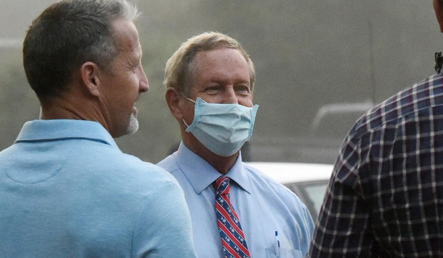 U.S. Rep. Joe Wilson, center, R-S.C., talks with state Reps. Chris Wooten, left, and Micah Caskey, right, at a get-out-the-vote event on Tuesday, Oct. 27, 2020, in West Columbia, S.C. (AP Photo/Meg Kinnard)