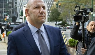 FILE- In this Oct. 17, 2019 file photo, David Correia walks from federal court in New York. A change-of-plea hearing is set for Thursday, Oct. 29, 20210, for Correia, who is charged with conspiring with associates of Rudy Giuliani, one of President Donald Trump's lawyers, to make illegal campaign contributions. (AP Photo/Craig Ruttle, File)