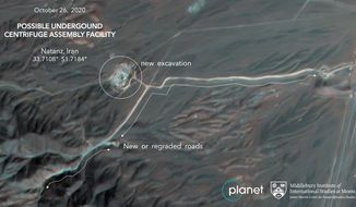 This Monday, Oct. 26, 2020, satellite image from Planet Labs Inc. that has been annotated by experts at the James Martin Center for Nonproliferation Studies at Middlebury Institute of International Studies shows construction at Iran's Natanz uranium-enrichment facility that experts believe may be a new, underground centrifuge assembly plant. Satellite photos show Iran has begun construction at its Natanz nuclear facility. That's after the head of the U.N.'s nuclear agency acknowledged Tehran is building an underground advanced centrifuge assembly plant after its last one exploded in a reported sabotage attack last summer. (Planet Labs Inc. via AP) ** FILE **