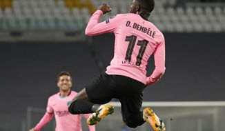 Barcelona's Ousmane Dembele celebrates scoring his side's opening goal during the Champions League group G soccer match between Juventus and Barcelona at the Allianz stadium in Turin, Italy, Wednesday, Oct. 28, 2020. (AP Photo/Antonio Calanni)