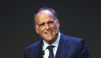 FILE - In this Monday, Sept. 24, 2018 file photo, Javier Tebas, the president of the Spanish La Liga, speaks during the World Football summit in Madrid, Spain. Tebas has accused Real Madrid president Florentino Perez of being behind the surprising announcement that Barcelona is pushing forward with the idea of a European Super League. In an interview The Associated Press on Wednesday, Oct. 28, 2020 he said it was Perez who prodded outgoing Barcelona president Josep Bartomeu to talk about the proposed new league in an effort to give it more credibility.  (AP Photo/Paul White, File)