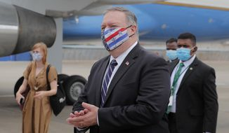 """In this file photo, U.S. Secretary of State Mike Pompeo walks to board an aircraft to leave for Maldives, in Colombo, Sri Lanka, Wednesday, Oct. 28, 2020. On Wednesday, the State Department that Mr. Pompeo will travel to Hanoi to """"reaffirm the strength of the U.S.-Vietnam comprehensive partnership and promote our shared commitment to a peaceful and prosperous region.""""  (AP Photo/Eranga Jayawardena, Pool)  **FILE**"""