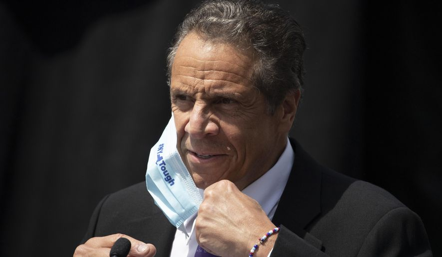 In this June 15, 2020, photo, New York Gov. Andrew Cuomo removes a mask as he holds a news conference in Tarrytown, N.Y. (AP Photo/Mark Lennihan) **FILE**