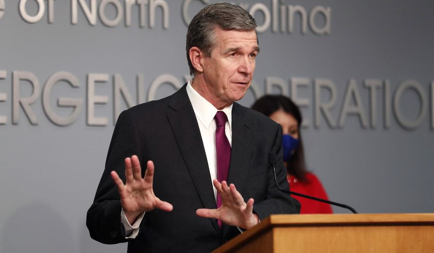 Gov. Roy Cooper answers a question during a briefing at the Emergency Operations Center in Raleigh, N.C., Wednesday, Oct. 28, 2020. Democratic Gov. Roy Cooper signed an executive order on Wednesday preventing landlords from evicting tenants who are unable to pay their rent.(Ethan Hyman/The News & Observer via AP)