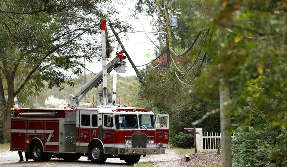 Officials issued warnings about downed power lines after one man was reported killed as Hurricane Zeta plowed across the South. (Associated Press)
