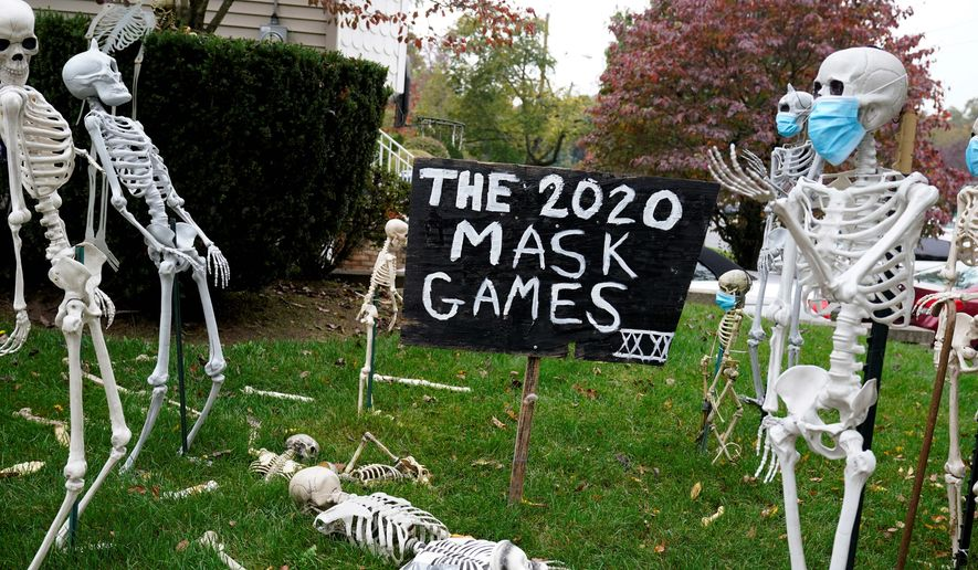 """""""Lower risk"""" activities, like decorating lawns with Halloween displays, are recommended by D.C. area leaders as a substitute for trick-or-treating during the pandemic. (Associated Press)"""