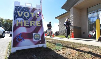 Voters wait in line to vote at the Hamilton County Election Commission, Thursday Oct. 29, 2020 on the final day for early voting in Chattanooga, Tenn.  (Matt Hamilton /Chattanooga Times Free Press via AP)