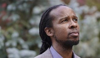 Ibram X. Kendi, director of Boston University's Center for Antiracist Research, stands for a portrait Wednesday, Oct. 21, 2020, in Boston. (AP Photo/Steven Senne) ** FILE **