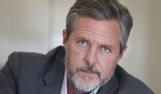 In this Nov. 16, 2016, file photo, Liberty University president Jerry Falwell Jr., poses during an interview in his offices at the school in Lynchburg, Va. Falwell filed a lawsuit Wednesday, Oct. 28, 2020, against Liberty University with defamation and breach of contract claims alleging the school damaged his reputation in statements after his resignation. (AP Photo/Steve Helber, File)