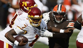 Cleveland Browns defensive end Myles Garrett (95) plays against Washington Football Team quarterback Dwayne Haskins (7) during the second half of an NFL football game, Sunday, Sept. 27, 2020, in Cleveland. (AP Photo/Ron Schwane)