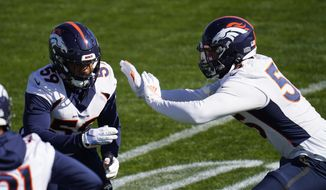 Denver Broncos outside linebackers Malik Reed, left, and Bradley Chubb take part in drills during an NFL football practice Wednesday, Oct. 28, 2020, at the team's headquarters in Englewood, Colo. (AP Photo/David Zalubowski)
