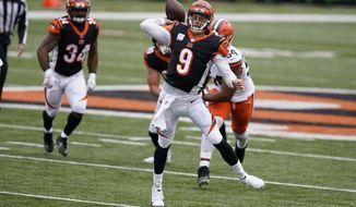 Cincinnati Bengals quarterback Joe Burrow (9) throws during the second half of an NFL football game against the Cleveland Browns, Sunday, Oct. 25, 2020, in Cincinnati. (AP Photo/Michael Conroy)