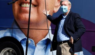 U.S. Sen. Lindsey Graham gestures to his campaign bus at a get-out-the-vote rally on Saturday, Oct. 17, 2020, in Columbia, S.C. (AP Photo/Meg Kinnard)