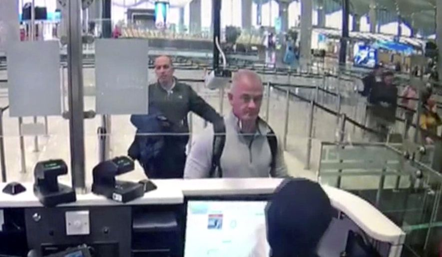 FILE -  This Dec. 30, 2019 image from security camera video shows Michael L. Taylor, center, and George-Antoine Zayek at passport control at Istanbul Airport in Turkey. The U.S. State Department has agreed to turn over to Japan Taylor and his son Peter Taylor, who are accused of smuggling former Nissan Motor Co. Chairman Carlos Ghosn out of the country while he was awaiting trial, the men's lawyers said in legal filing on Thursday, Oct. 29, 2020. (DHA via AP)