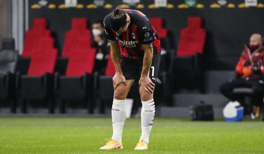 AC Milan's Zlatan Ibrahimovic touches his knees during the Europa League Group H soccer match between AC Milan and Sparta Praha at the San Siro Stadium, in Milan, Italy, Thursday, Oct. 29, 2020. (AP Photo/Antonio Calanni)