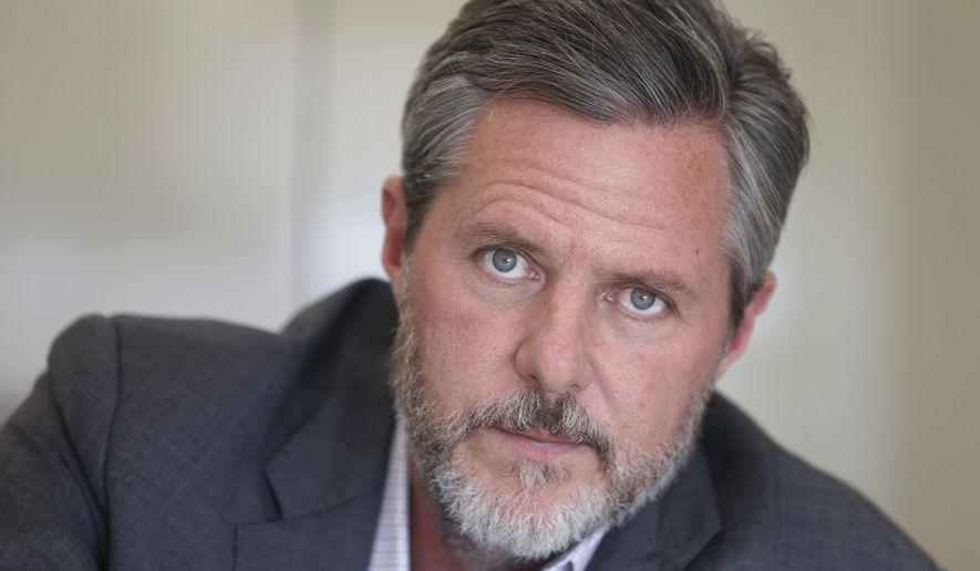 In this Nov. 16, 2016, file photo, then-Liberty University President Jerry Falwell Jr., poses during an interview in his offices at the school in Lynchburg, Va. (AP Photo/Steve Helber, File)