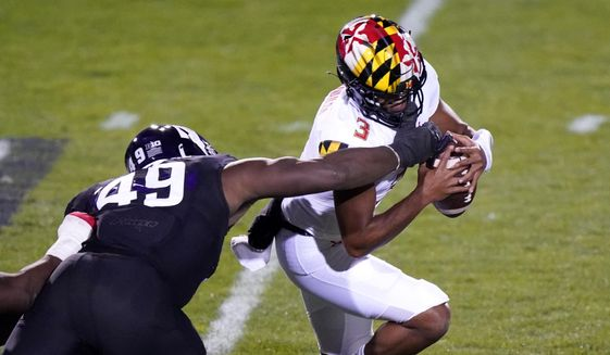 Maryland quarterback Taulia Tagovailoa is sacked by Northwestern defensive line Adetomiwa Adebawore during the second half of an NCAA college football game in Evanston, Ill., Saturday, Oct. 24, 2020. (AP Photo/Nam Y. Huh)  **FILE**