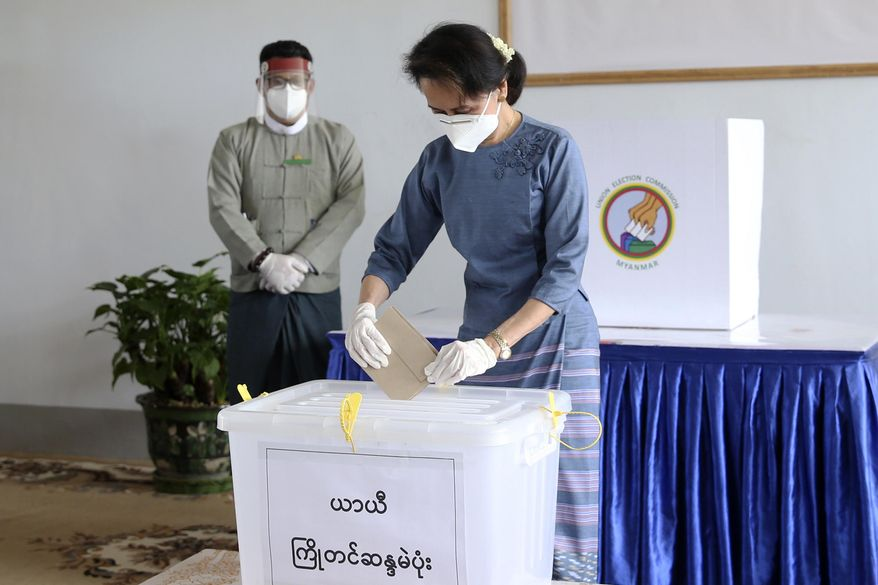 Myanmar's leader Aung San Suu Kyi makes an early voting for upcoming Nov. 8 general election at Union Election Commission office, Thursday, Oct. 29, 2020, in Naypyitaw, Myanmar. (AP Photo/Aung Shine Oo)