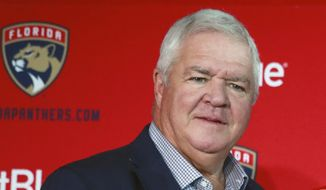 FILE - This is a July 2, 2019, file photo showing Florida Panthers President of Hockey Operations & General Manager Dale Tallon at a news conference in Sunrise, Fla. The National Hockey League on Thursday, Oct. 29, 2020, cleared Tallon of any wrongdoing after an independent investigation found claims he made inappropriate racial, religious and ethnic comments as general manager of the Florida Panthers were not substantiated. (AP Photo/Wilfredo Lee, File)