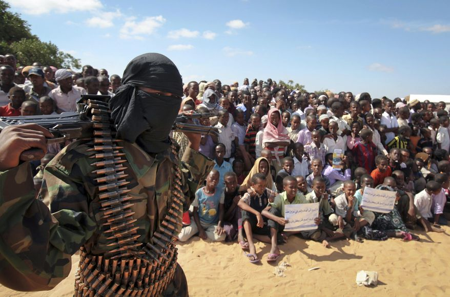 In this Feb. 13, 2012, file photo, an armed member of the militant group al-Shabab attends a rally on the outskirts of Mogadishu, Somalia. (AP Photo, File)  **FILE**
