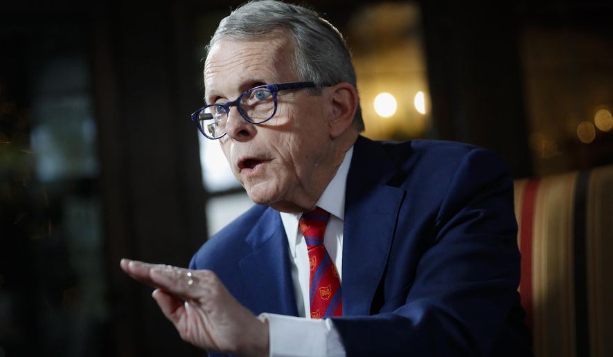 In this Dec. 13, 2019, file photo, Ohio Gov. Mike DeWine speaks during an interview at the Governor's Residence in Columbus, Ohio. The state surpassed a new daily virus record Thursday, Oct. 29, 2020, with more than 3,500 cases as Ohio joins dozens of states in a third surge of infections as the country enters the colder months. (AP Photo/John Minchillo, File)