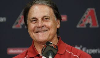 FILE - In this July 22, 2014, file photo, Arizona Diamondbacks Chief Baseball Officer Tony La Russa smiles as he talks about his upcoming induction ceremony into the Baseball Hall of Fame during a news conference in Phoenix. La Russa, the Hall of Famer who won a World Series championship with the Oakland Athletics and two more with the St. Louis Cardinals, is returning to manage the Chicago White Sox 34 years after they fired him, the team announced Thursday, Oct. 29, 2020. (AP Photo/File)