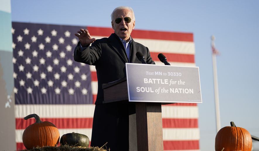 Democratic presidential candidate former Vice President Joe Biden speaks during a campaign rally at the Minnesota State Fairgrounds in Saint Paul, Minn., Friday, Oct. 30, 2020. (AP Photo/Andrew Harnik)