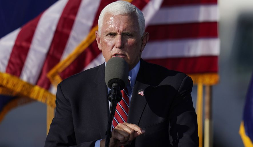 Vice President Mike Pence speaks at a campaign rally at Tucson International Airport Friday, Oct. 30, 2020, in Tucson, Ariz. (AP Photo/Ross D. Franklin)