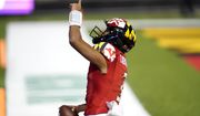 Maryland quarterback Taulia Tagovailoa reacts after scoring a touchdown on a run against Minnesota during the first half of an NCAA college football game, Friday, Oct. 30, 2020, in College Park, Md. (AP Photo/Julio Cortez)