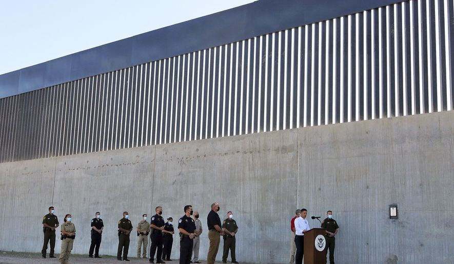 Acting Homeland Secretary Chad Wolf gives a speech in front of a new section of the border wall Thursday, Oct. 29, 2020, in McAllen, Texas. (Joel Martinez/The Monitor via AP) **FILE**