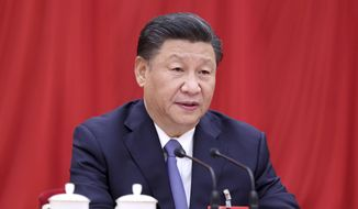In this photo released by Xinhua News Agency, Chinese President Xi Jinping, also general secretary of the Communist Party of China (CPC) Central Committee, speaks during fifth plenary session of the 19th CPC Central Committee in Beijing on Oct 29, 2020. (Ju Peng/Xinhua via AP)