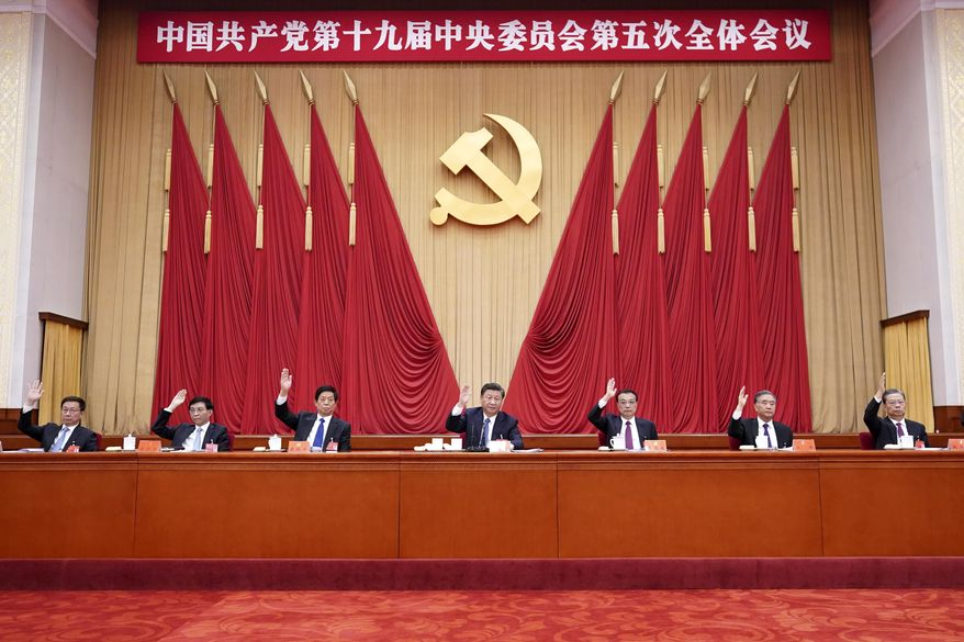 "In this photo released by Xinhua News Agency, Chinese President Xi Jinping, also general secretary of the Communist Party of China (CPC) Central Committee, leads other Chinese leaders attending the fifth plenary session of the 19th Central Committee of the Communist Party of China (CPC) in Beijing, China on Oct. 29, 2020. China's leaders are vowing to make their country a self-reliant ""technology power"" after a meeting to draft a development blueprint for the state-dominated economy over the next five years. (Wang Ye/Xinhua via AP)"