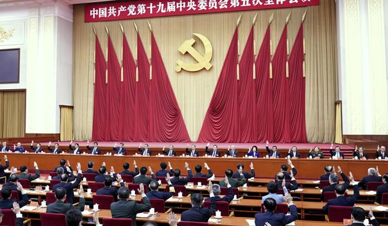 """In this photo released by Xinhua News Agency, the Political Bureau of the Communist Party of China (CPC) Central Committee presides over the fifth plenary session of the 19th CPC Central Committee in Beijing, China on Oct 29, 2020. China's leaders are vowing to make their country a self-reliant """"technology power"""" after a meeting to draft a development blueprint for the state-dominated economy over the next five years. (Yin Bogu/Xinhua via AP)"""