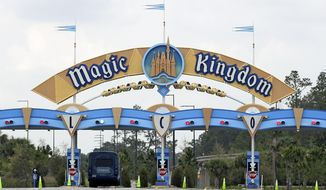 FILE - In this March 16, 2020, file photo, the entrance to the parking lot at the Magic Kingdom at Walt Disney World is closed in Lake Buena Vista, Fla. Squeezed by limits on attendance at its theme parks and other restrictions due to the pandemic, The Walt Disney Co. said Tuesday, Sept. 29, 2020, it planned to lay off 28,000 workers in its parks division in California and Florida. (AP Photo/John Raoux, File)