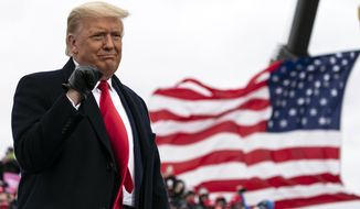 President Donald Trump arrives to speak at a campaign rally at Oakland County International Airport, Friday, Oct. 30, 2020, at Waterford Township, Mich. (AP Photo/Alex Brandon)