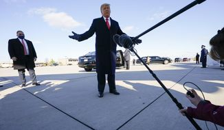 President Donald Trump speaks to reporters before a campaign rally at Green Bay Austin Straubel International Airport, Friday, Oct. 30, 2020, in Green Bay, Wis. (AP Photo/Alex Brandon)