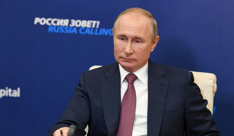 In this file photo, Russian President Vladimir Putin attends an annual VTB Capital 'Russia Calling!' Investment Forum via video conference at the Novo-Ogaryovo residence outside Moscow, Russia.  Mr. Putin has instituted a national public masking mandate in Russia, similar to a measure that Joseph R. Biden said he would institute on a national level as president. (Alexei Nikolsky, Sputnik, Kremlin Pool Photo via AP, File) **FILE**